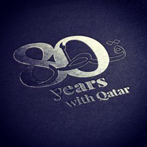 Logo anniversaire pour fêter les 80 ans de présence de Total au Qatar